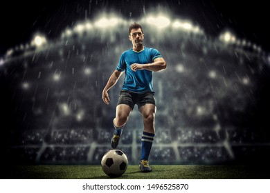 Soccer player kicks the ball on the soccer stadium. He wear unbranded sports clothes. Stadium