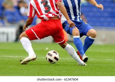 Fußball-Beine in Aktion