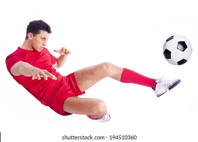Soccer player making an acrobatic kick, isolated on white background