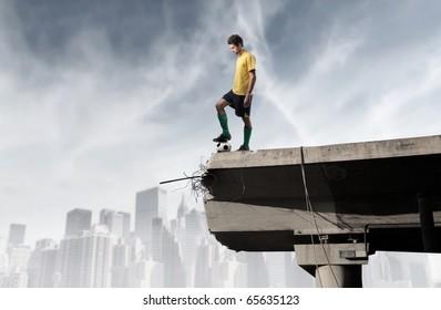Soccer player on the edge of a broken bridge