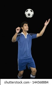 Soccer player practicing heading the ball