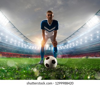 Soccer player ready to kick the soccerball at the stadium during the match