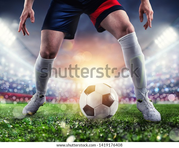 Soccer player ready to kick the soccerball at the stadium during the match.