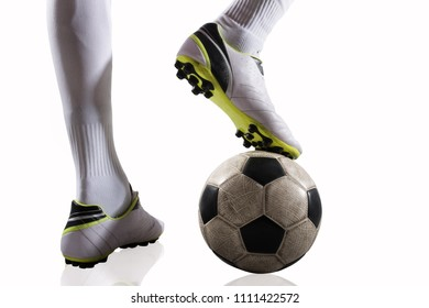 Soccer player with soccerball ready to play. Isolated on white background