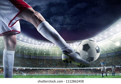 Soccer player with soccerball at the stadium ready for the match