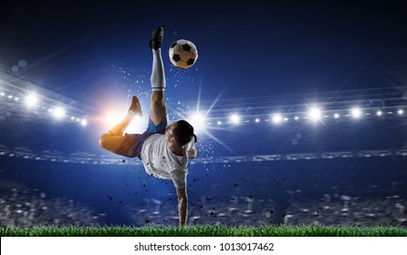 Soccer player at stadium. Mixed media - Shutterstock ID 1013017462