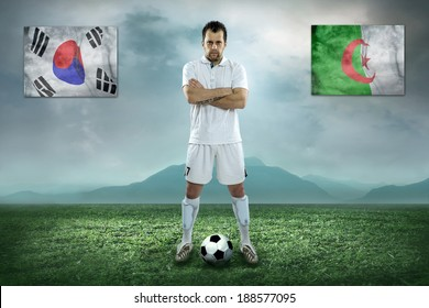 Soccer player stay at field. Game between Korea and Algeria national teams.