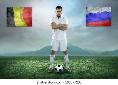 Soccer player stay at field. Game between Belgium and Russia national teams.