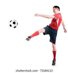 soccer player strongly hits the ball, isolated on white