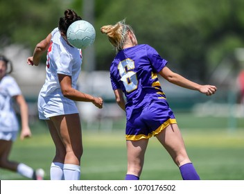 Soccer player using head to hit the ball