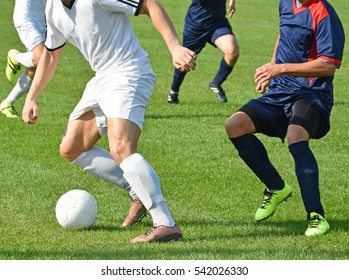 Soccer players in action on the match