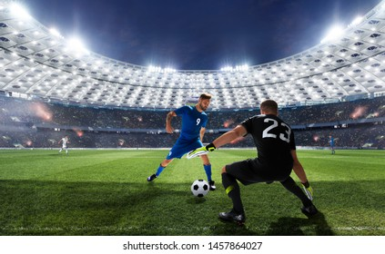 Soccer players in action on professional stadium in evening.