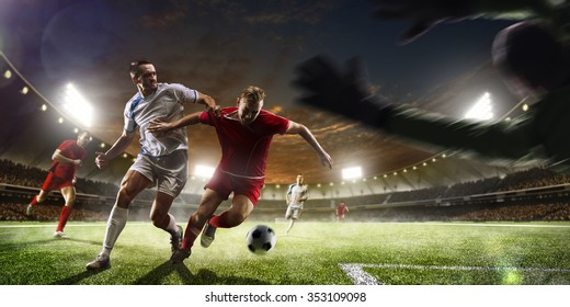 Photo of Soccer players in action on the sunset stadium background panorama