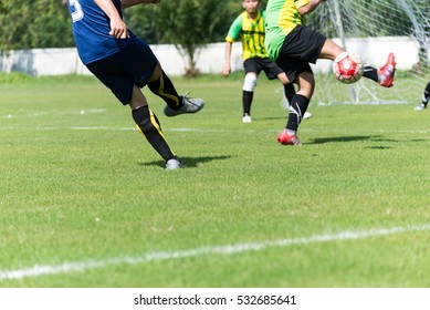 Soccer players in action playing football match