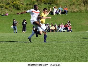 Soccer Players battling for position, high action