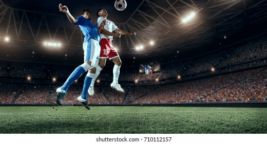 Soccer players performs an action play on a professional stadium. All players wear unbranded clothes. The stadium is made in 3D.