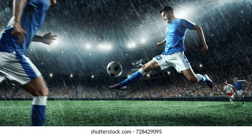 Soccer players performs an action play on a professional rainy stadium. All players wears unbranded clothes. The stadium is made in 3D.