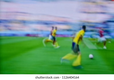 Soccer players at the pitch. Blurred soccer game.