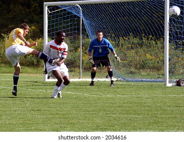 Soccer Players, player jumping high and kicking the ball in front of the net