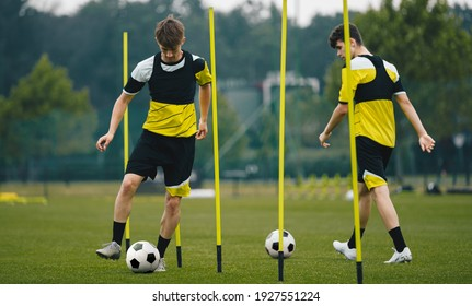 Soccer Players Running With Balls in Between Training Poles. Football Practice Session for Youth Sports Club