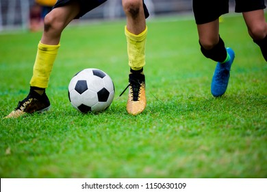 Soccer players trap and control the ball for shoot to goal. Soccer players fighting each other by kicking the ball.