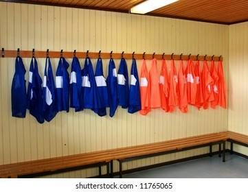 Soccer practice vests hanging in a locker room