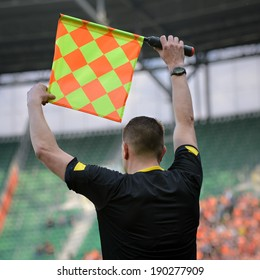Soccer referee giving signal a change of players