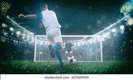 Soccer scene at night match with player in a white and blue uniform kicking the penalty kick