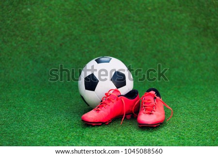 146915948 Soccer Shoes Soccer Ball On Grass Stock Photo (Edit Now) 1045088560 ...