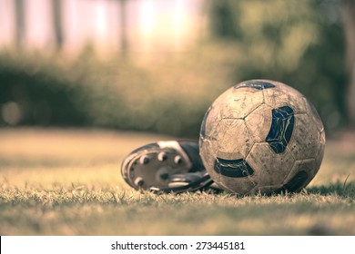 Soccer shoes & football on the green grass-Filtered Image