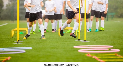 Soccer Skills Training Session. Players Training on the Field. Soccer Obstacle Course. Grass Football Field. Coaching Soccer Gear Equipment for Field Training