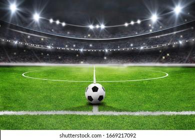 Das Fußballstadion mit dem Ball auf der Strecke