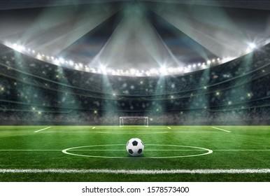 soccer stadium in the evening - ball in midfield