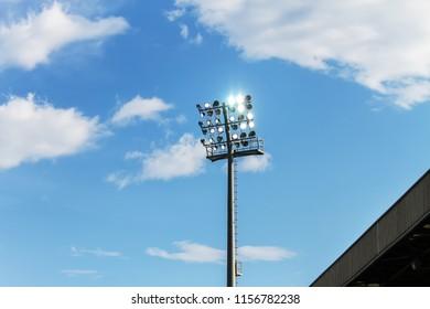 Soccer stadium lights over cloudy sky