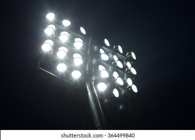 Soccer Stadium Lights over Dark Night Sky Background