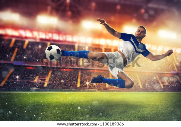Soccer striker hits the ball with an acrobatic kick