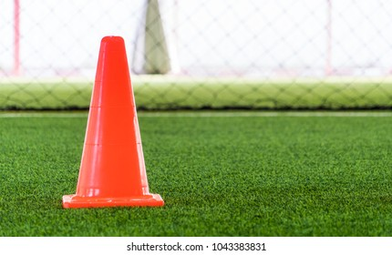 Soccer training cone on indoor soccer training ground