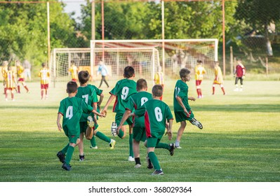 Soccer training for kids in football field