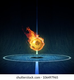 Soccerball on Fire or burning Soccerball on indoor soccer field
