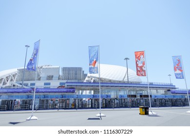 Sochi, Adler, Russia, 13 June 2018: Stadium Fisht and colored flags with the official mascot of the 2018 FIFA World Cup Zabivaka wolf.