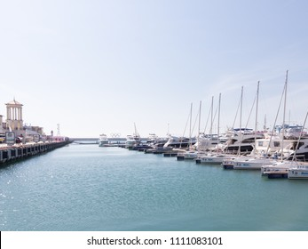 Sochi - April 7, 2017: many yachts in the city port and Olympic rings away April 7, 2017, Sochi, Russia