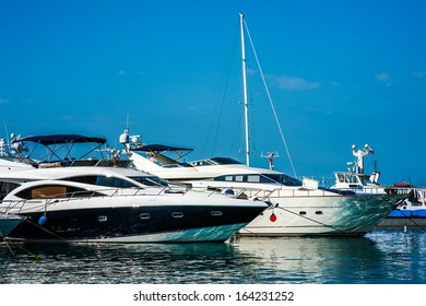 SOCHI - JUNE 21: Sale boats is on the jetty of Commercial Sea Port of Sochi on June 12, 2012 in Sochi, Russia. This is an important hub on the Black Sea coast of Russia