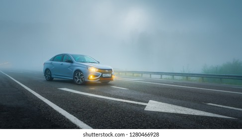 Sochi, Krasnodar region, Russia - August 31, 2018: Тhe new prestigious LADA Vesta Sport car on high-speed roads. Car in blue fog with yellow light. Presentation the new vehicle production of AVTOVAZ