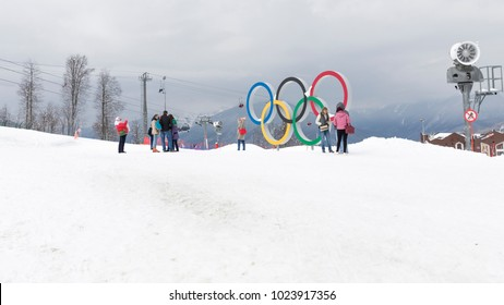 Sochi - March 29, 2017: A group of people near the bright Olympic rings in the Olympic skiing cluster March 29, 2017, Sochi, Russia