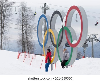 Sochi - March 29, 2017: People are photographed against the backdrop of olympic rings in the Olympic Park in Sochi, March 29, 2017, Sochi, Russia