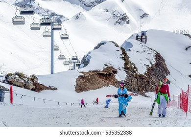 Sochi, Russia - April 10, 2014: Snowy ski slopes and chair lifts in Gorky Gorod winter mountain resort can be hosting ski and snowboard riders for 6 months a year
