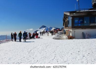 Sochi, Russia - April 3, 2017: Ski resort Rosa Khutor. Tourists near the Vysota 2320 restaurant. Krasnaya Polyana, Krasnodar Krai, Russia