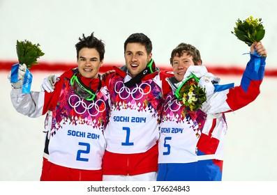 SOCHI, RUSSIA - FEB 10, 2014: KINGSBURY (CAN), BILODEAU (CAN), SMYSHLYAEV (RUS) at Men's Moguls flower ceremony of Freestyle skiing at Sochi 2014 XXII Olympic Winter Games