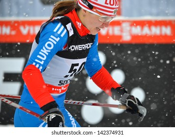 SOCHI, RUSSIA - FEBRUARY 1: Polina Kovaleva competes in the FIS Cross-Country  World Cup on February 1, 2013 in Sochi, Russia. Combined ski and biathlon complex Laura