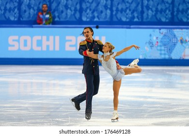 Sochi, RUSSIA - February 11, 2014: Tatiana VOLOSOZHAR and Maxim TRANKOV (RUS) on ice during figure skating competition of pairs in short program at Sochi 2014 XXII Olympic Winter Games